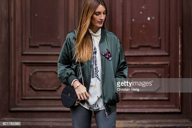 Fashion Blogger and Owner of SCIC Swimwear Sofia Grau wearing a white blouse Lala Berlin a green jacket Zara grey ruffled pants otherstories black...