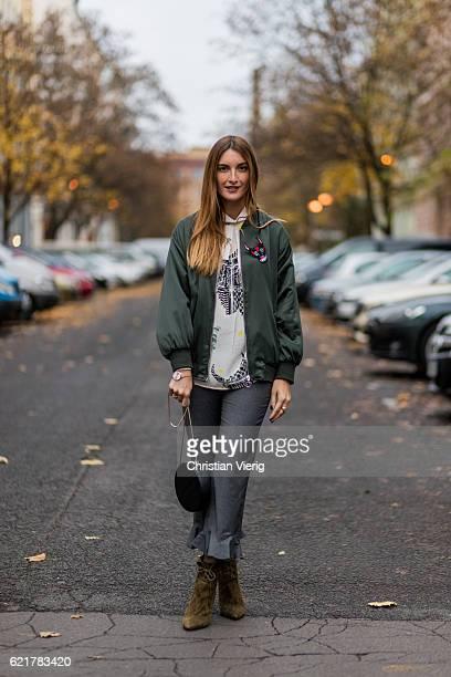 Fashion Blogger and Owner of SCIC Swimwear Sofia Grau wearing a white blouse Lala Berlin a green jacket Zara grey ruffled pants otherstories khaki...