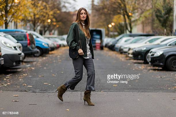 Fashion Blogger and Owner of SCIC Swimwear Sofia Grau wearing a white blouse Lala Berlin a green jacket Zara grey ruffled pants otherstories khaki...