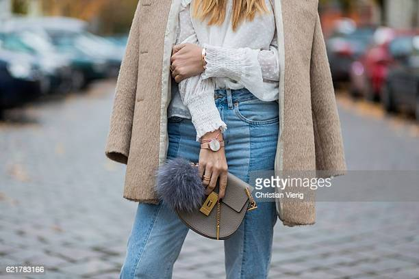 Fashion Blogger and Owner of SCIC Swimwear Sofia Grau wearing light blue two tone HM denim jeans a grey bag Chloe a white blouse Zara a beige coat...