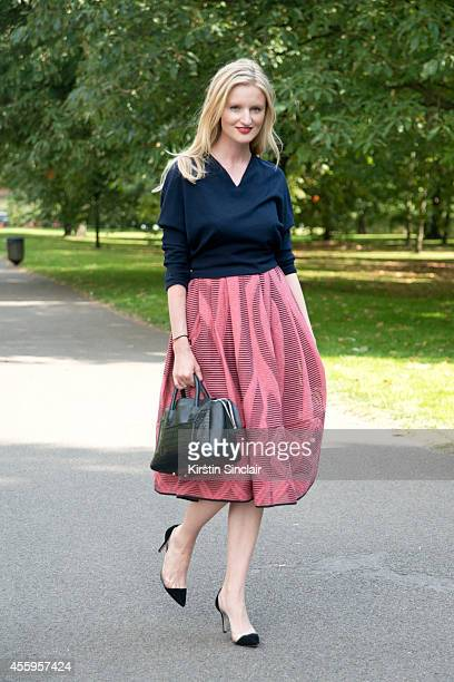 Fashion Blogger and Photographer Candice Lake is wearing a Balenciaga top Tibi skirt Gianvito Rossi shoes and an Emm Kuo bag on day 4 of London...