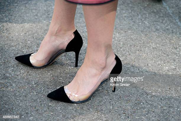 Fashion Blogger and Photographer Candice Lake is wearing Gianvito Rossi shoes on day 4 of London Collections Women on September 15 2014 in London...