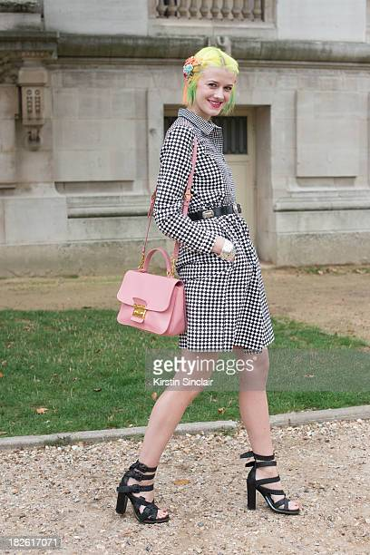 Fashion blogger and photographer Marianne Theodorsen wears YMC dress Miu Miu bag Alexander Wang shoes and a vintage belt on day 8 of Paris Fashion...