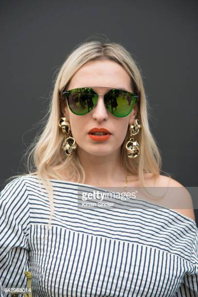 Fashion blogger and stylist Camila Carril wears an Eudon Choi dress Dior Sunglasses and vintage earrings on day 1 of London Womens Fashion Week...