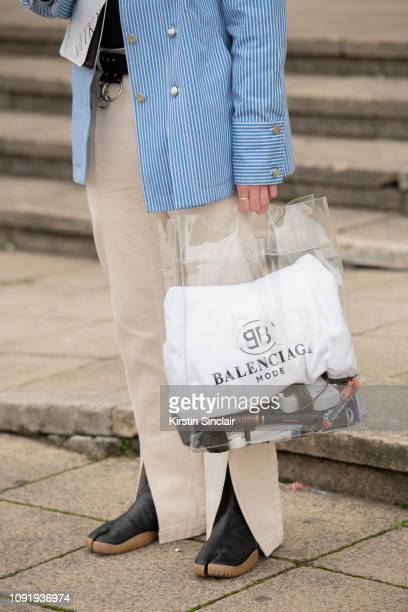 Fashion blogger and Stylist Luke Pearson wears Off White trainers, Balenciaga bag, End clothing trousers, Maison Margiela bag and a Delada jacket...