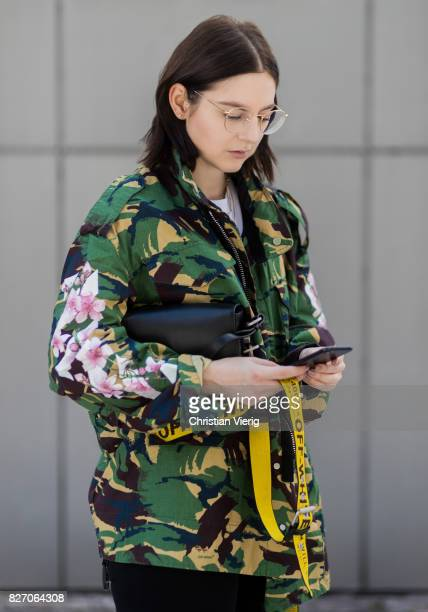 Fashion blogger and stylist Maria Barteczko wearing an Off White jacket with camouflage print white Balenciaga tshirt glasses black Citizens of...