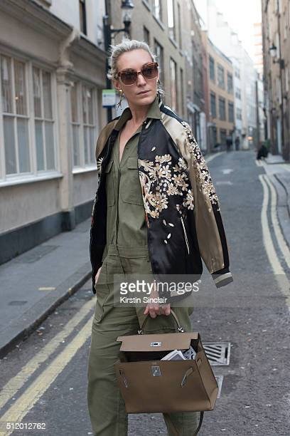 Fashion blogger and writer Olivia Buckingham wears a Zara bomber jacket Maje jumpsuit Chloe sunglasses Hermes bag and Marni earrings on day 5 during...