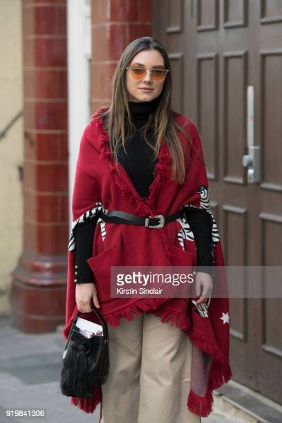 Fashion blogger Andrea Cristea wears a Hayley Menzies wool jacket Regina Pyo sunglasses Pinko trousers vintage bag on day one of London Womens...