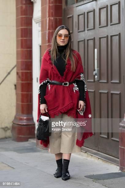 Fashion blogger Andrea Cristea wears a Hayley Menzies wool jacket Regina Pyo sunglasses Pinko trousers vintage bag Zara shoes on day one of London...