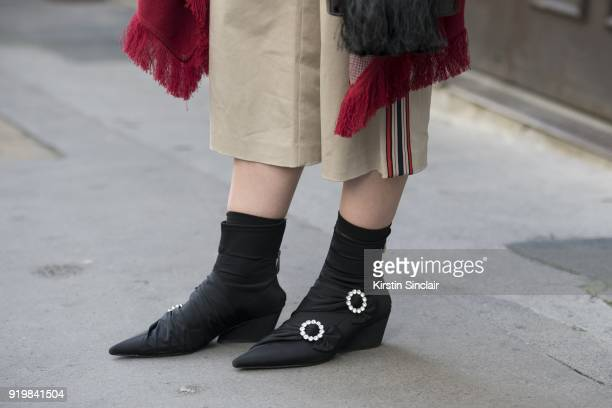 Fashion blogger Andrea Cristea wears Zara shoes on day one of London Womens Fashion Week Autumn/Winter 2018 on February 16 2018 in London England