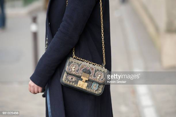 Fashion blogger Andreea Cristea of stilettoshades wears a Dior bag Coat Co coat day 2 of Paris Womens Fashion Week Spring/Summer 2018 on February 27...