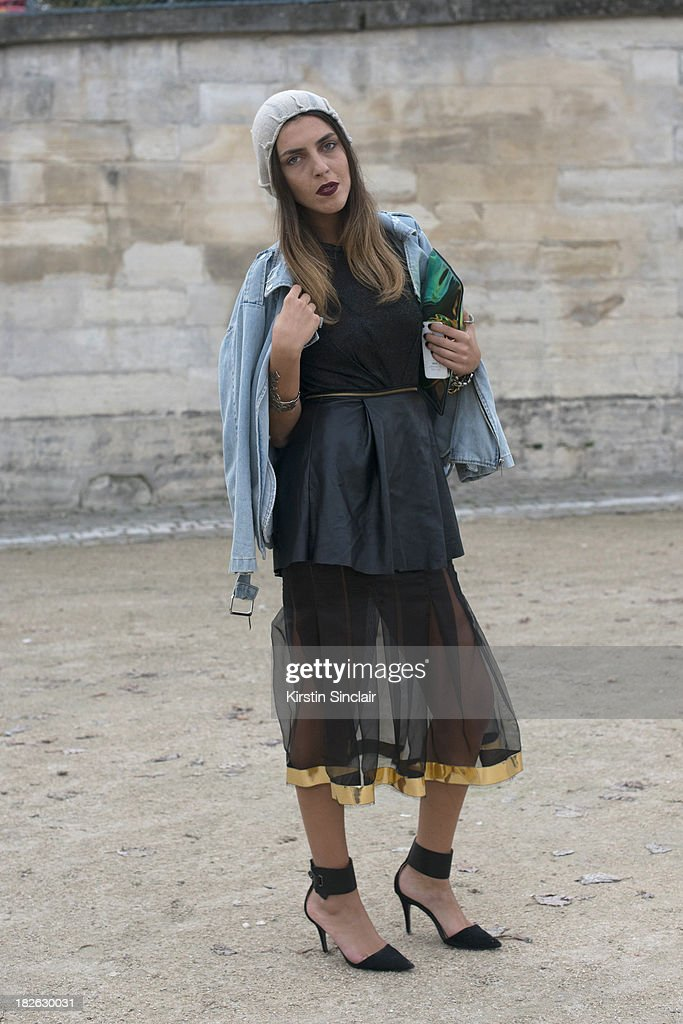 Fashion blogger Andria Aletrari wars Chicy jacket, Nator Georgiou dress and hat, H and M bag and Zara shoes on day 7 of Paris Fashion Week Spring/Summer 2014, Paris September 30, 2013 in Paris, France.