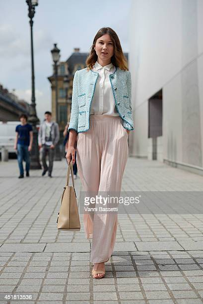 Fashion Blogger Angelica Ardasheva poses wearing Zara jacket shirt and pants Mango shoes and Gianni Chiarini bag after Schiapparelli show on July 7...