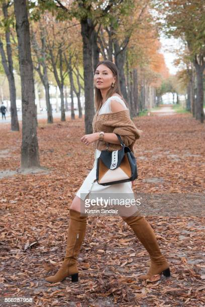 Fashion blogger Angelica Ardasheva wears a Mes Demoiselles sweater ASOS top Forever21 skirt Manurina bag and Zara boots'n day 2 of Paris Womens...