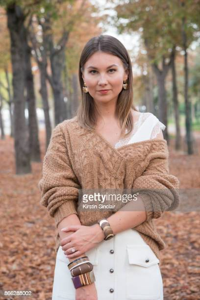 Fashion blogger Angelica Ardasheva wears a Mes Demoiselles sweater ASOS top Forever21 skirt day 2 of Paris Womens Fashion Week Spring/Summer 2018 on...