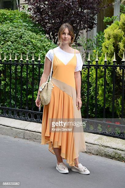 Fashion blogger Angelica Ardasheva wears an ASOS dress South Beach bag and Stradivarius sneakers day 2 of Paris Haute Couture Fashion Week...