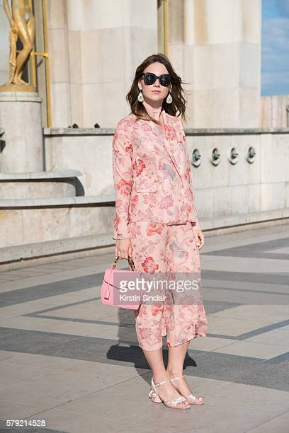 Fashion blogger Angelica Ardasheva wears an ASOS pyjama suit and shoes Celine sunglasses and Buti bag on day 3 of Paris Haute Couture Fashion Week...