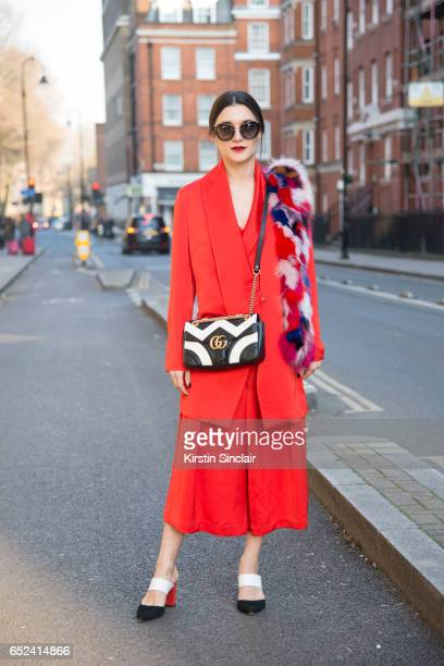 Fashion blogger Anisa Sojka wears a Luvon suit Faber Novella shoes Gucci bag Miu Miu sunglasses and a Jane and Hash scarf on day 2 of London Womens...