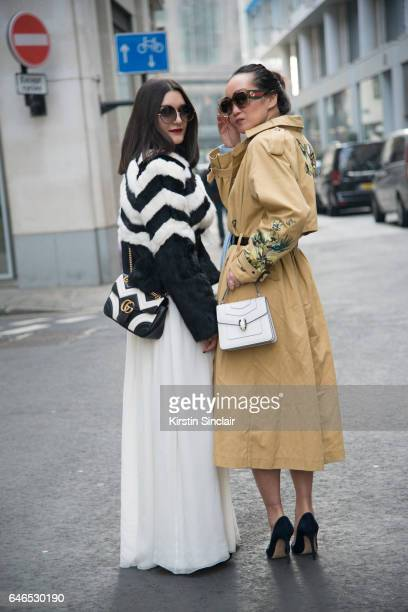 Fashion blogger Anisa Sojka wears a Matthew Williamson coat and sunglasses Jessica Choy dress Gucci bag with Fashion blogger Mariko Kuo who wears a...