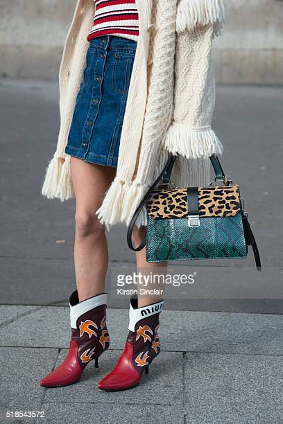 Fashion Blogger Anna Carla Simona wears Philosophy coat Topshop shirt and skirt Miu Miu bag and shoes on day 5 during Paris Fashion Week...