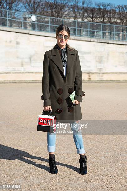 Fashion Blogger Anna Fasano wears a Les Petits Joueurs bag on day 4 during Paris Fashion Week Autumn/Winter 2016/17 on March 4 2016 in Paris France