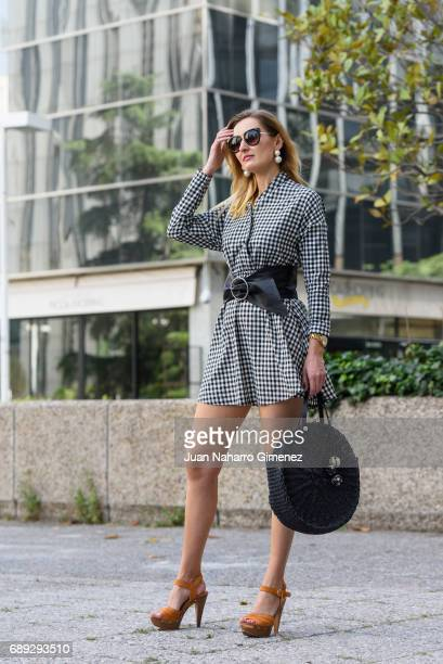Fashion blogger Anna Nazarova is wearing Cuple shoes Asos dress and earrings ZARA hangbag River Island glases and Marc Jacobs whatch on May 28 2017...