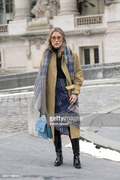 Fashion blogger Annabel Rosendahl wears a JW Anderson bag TIBI coat Victoria Beckham sunglasses Acne scarf boots and skirt day 4 of Paris Womens...