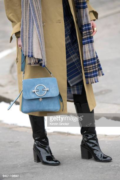Fashion blogger Annabel Rosendahl wears a JW Anderson bag TIBI coat Acne scarf boots and skirt day 4 of Paris Womens Fashion Week Spring/Summer 2018...