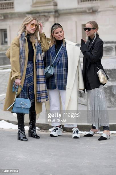 Fashion blogger Annabel Rosendahl wears a JW Anderson bag TIBI coat Victoria Beckham sunglasses Acne scarf boots and skirt with TV Host and founder...