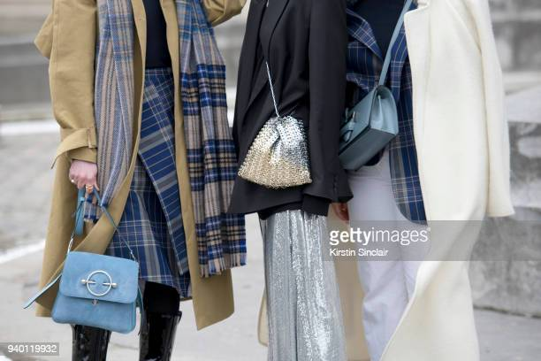 Fashion blogger Annabel Rosendahl wears a JW Anderson bag TIBI coat Acne scarf and skirt with Fashion blogger Celine Aagaard wearing an And Other...