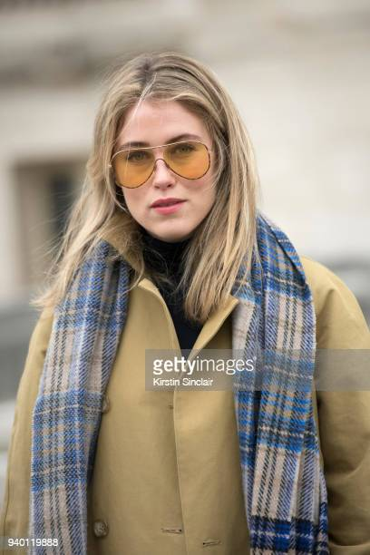 Fashion blogger Annabel Rosendahl wears a Tibi coat Victoria Beckham sunglasses Acne scarf day 4 of Paris Womens Fashion Week Spring/Summer 2018 on...