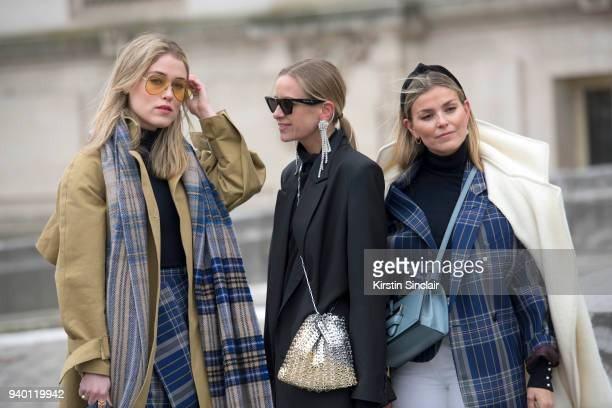 Fashion blogger Annabel Rosendahl wears a TIBI coat Victoria Beckham sunglasses Acne scarf and skirt with Fashion blogger Celine Aagaard wearing...