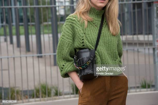 Fashion blogger Annabel Rosendahl wears an Isabel Marant sweater Acne trousers Paco Rabanne bag day 3 of Paris Womens Fashion Week Spring/Summer 2018...