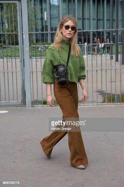 Fashion blogger Annabel Rosendahl wears an Isabel Marant sweater Acne trousers Paco Rabanne bag and Celine sunglasses day 3 of Paris Womens Fashion...