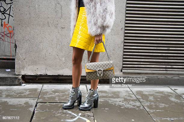 Fashion Blogger Annacarla e Simona is wearing top and jacket by Topshop skirt by Miu Miu bag by Gucci and shoes by Louis Vuitton day 1 of London...