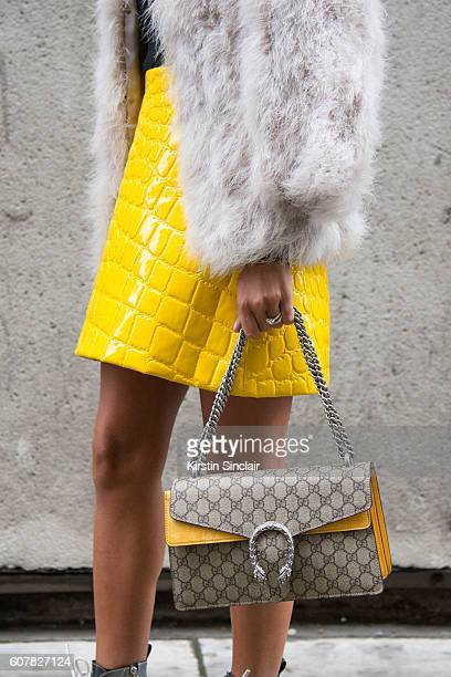 Fashion Blogger Annacarla e Simona is wearing top and jacket by Topshop skirt by Miu Miu and bag by Gucci day 1 of London Womens Fashion Week...