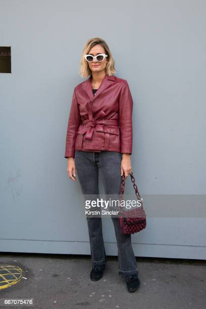 Fashion blogger AnneLaure Mais Adenorah wears a Ganni jacket Levis jeans vintage sunglasses Jonak shoes on day 4 of London Womens Fashion Week...