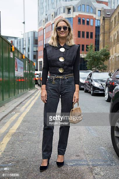Fashion blogger AnneLaure Mais wears a Opening Ceremony top vintage Levis jeans Rupert Sanderson shoes vintage bag and glasses on day 3 of London...