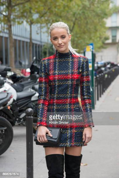 Fashion blogger at InTheFrow Victoria Magrath wears a Balmain dress Louis Vuitton bag and Gianvito Rossi boots day 3 of Paris Womens Fashion Week...