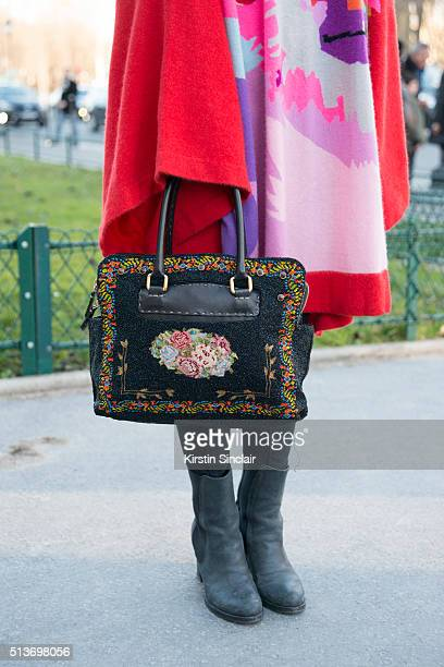 Fashion Blogger Atias Huynh wears a Yang sweater and a Fendi bag on day 3 during Paris Fashion Week Autumn/Winter 2016/17 on March 3 2016 in Paris...