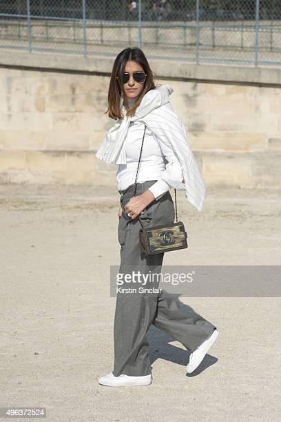 Fashion Blogger Atosa Nikkhah wears River Island trousers Zara top Gestuz blazer Chanel bag Yves Saint Laurent sunglasses and Superga shoes on day 5...