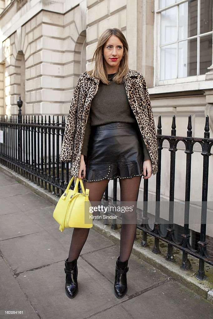 Fashion Blogger Babel Juane wears a vintage jacket, Zara top, dress, shoes and purse on day 3 of London Womens Fashion Week Autumn/Winter 2013 on February 17, 2013 in London, England.