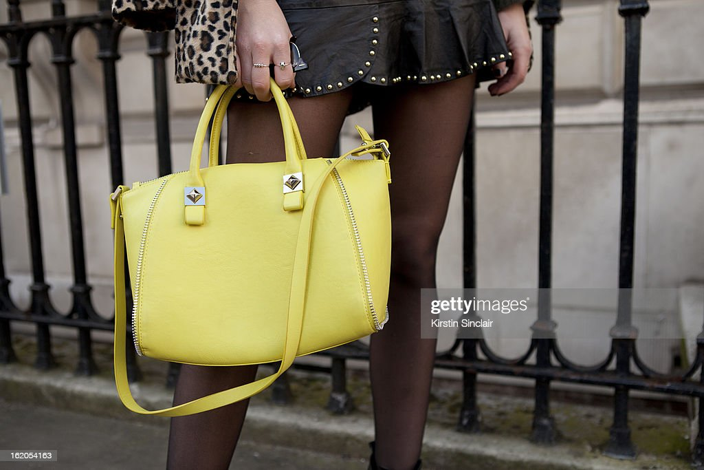 Fashion Blogger Babel Juane with a Zara purse on day 3 of London Womens Fashion Week Autumn/Winter 2013 on February 17, 2013 in London, England.