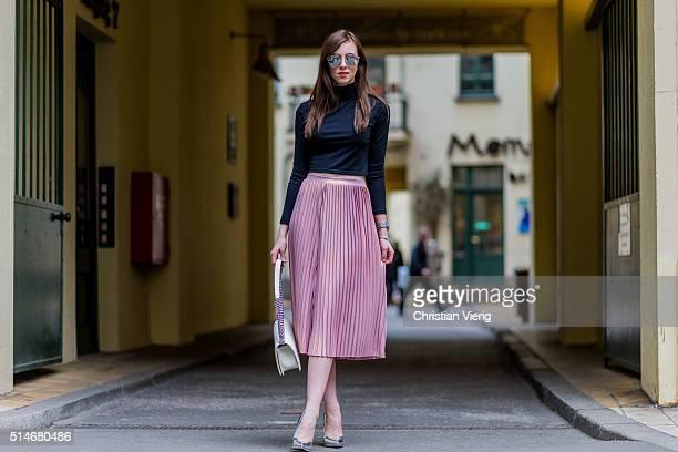 Fashion blogger Barbora Ondrackova wearing a black Topshop top a pink Asos skirt silver Asos heels a white Chanel bag silver Dior sunglasses on March...