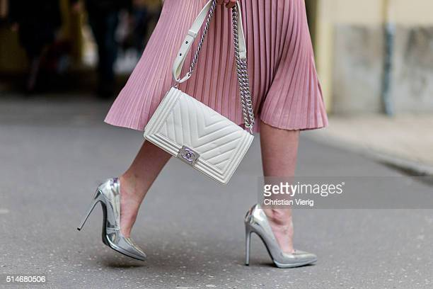 Fashion blogger Barbora Ondrackova wearing a pink Asos skirt silver Asos heels white Chanel bag sunglasses on March 10 2016 in Berlin Germany