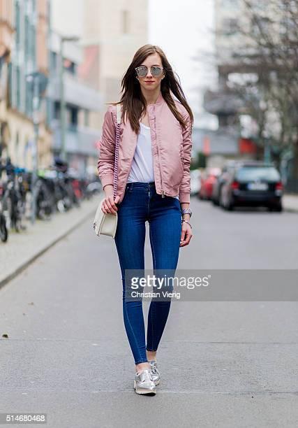 Fashion blogger Barbora Ondrackova wearing a pink Topshop bomber jacket blue Topshop denim jeans a white Chanel bag silver Zara shoes silver Dior...