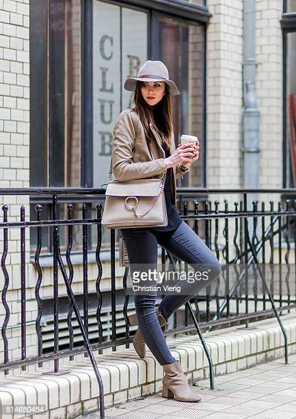 Fashion blogger Barbora Ondrackova wearing an HM hat a black Proenza Schouler sweater a beige Zara jacket black Topshop denim jeans beige Zara boots...