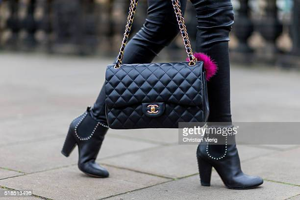 Fashion Blogger Barbora Ondrackova wearing black leggings from Balenciaga a black Chanel bag black heeled Chelsea ankle boots from Givenchy on April...