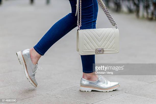 Fashion blogger Barbora Ondrackova wearing blue Topshop denim jeans a white Chanel bag silver Zara shoes on March 10 2016 in Berlin Germany