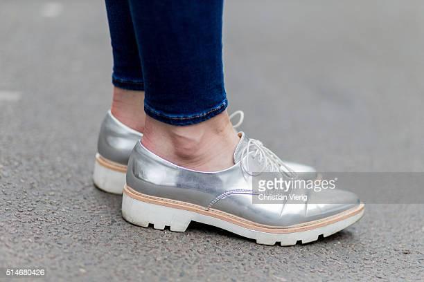 Fashion blogger Barbora Ondrackova wearing blue Topshop denim jeans silver Zara shoes on March 10 2016 in Berlin Germany